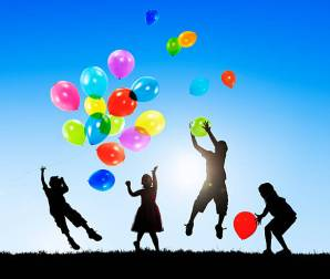 Children Outdoors Playing Balloons Together